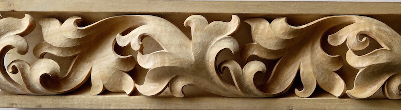 Wood-carved Gothic-style spiraling leaf moulding by Agrell Architectural Carving.