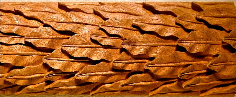 Wood-carved Roman-style laurel leaf moulding based on a design found at the Arch of Titus. By Agrell Architectural Carving.