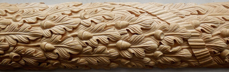 Wood-carved ribbon and oak leaf moulding by Agrell Architectural Carving.