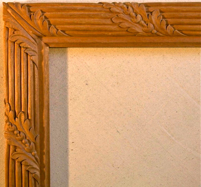 Wood-carved acanthus and reed moulding with a properly executed miter. By Agrell Architectural Carving.