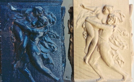 Carved pilaster bases depicting The Rape of the Sabine Women