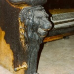 Carved lion bench damaged by fire