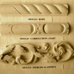 Rope, cabouchon, and acanthus-leaf moulding motifs.