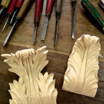 Baroque-style acanthus woodcarvings, based on a cornice design found at Strahov Abbey in Prague and hand-carved by Agrell Architectural Carving
