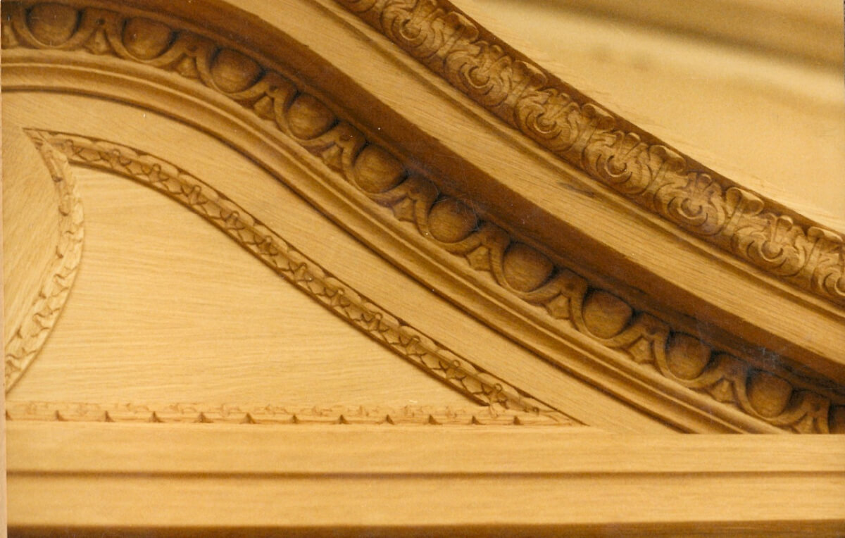 A detail of an oak pediment for the Sultan of Brunei's private London residence, hand-carved by Agrell Architectural Carving.