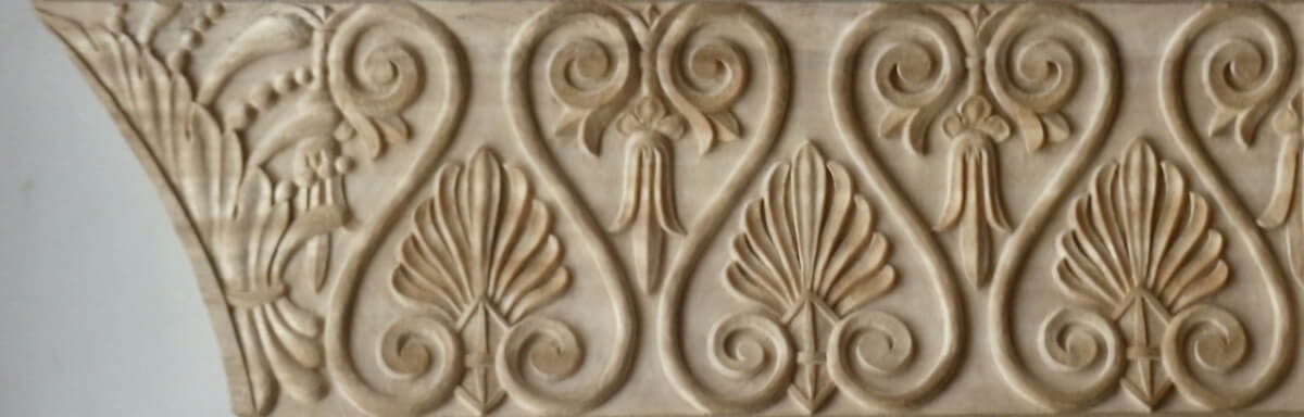 Neoclassical-style wood moulding with acanthus leaves and honeysuckle, hand-carved by Agrell Architectural Carving