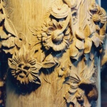 Oak newel post with hand-carved roses