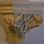 Carved wood capital in the Romanesque style