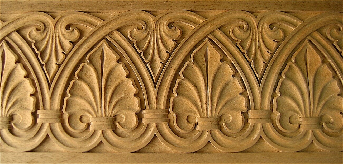 Carved Romanesque-style band moulding