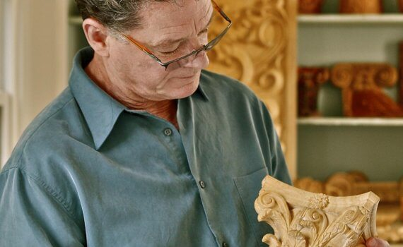 Master Carver Ian Agrell with a hand-carved corinthian capital